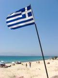 Greek Flag. On the Beach of Naxos Royalty Free Stock Photo