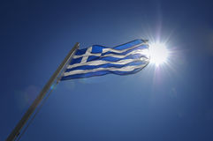 Greek Flag. At the top of a flag pole waving in the sunshine stock image