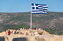Greek flag on Acropolis of Athens on August 1, 2013. Greece. Stock Photo