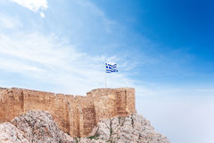 Greek flag on Acropolis in Athens, Greece. Greek flag on sky background in Acropolis of Athens, Greece royalty free stock images