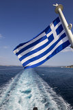 A Greek flag in the Aegean. On August 12, 2012 in Chalkidiki, Greece royalty free stock photo