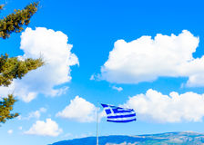 Greek flag against Greek sky Stock Photography
