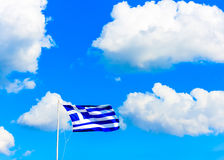 Greek flag against Greek sky Stock Images