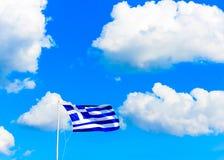 Greek flag against Greek sky Stock Images