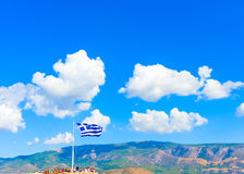 Greek flag against Greek sky Royalty Free Stock Images