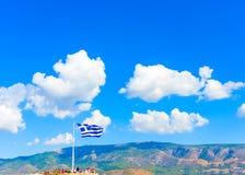 Greek flag against Greek sky Royalty Free Stock Images