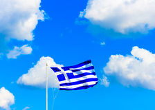 Greek flag against Greek sky Royalty Free Stock Photo