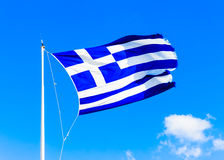 Greek flag against Greek sky Royalty Free Stock Photography