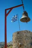 Greek flag and bell. Greek flag on the tower and bell royalty free stock photo