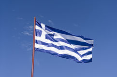 Greek flag in blue sky. Greek flag in the wind against the blue sky Royalty Free Stock Images