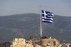 Greek flag on blue sky background. Acropolis, Athens, Greece. A gigantic Greek flag on the Athenian Acropolis. The national flag royalty free stock image
