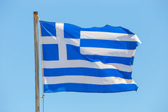 Greek flag on the blue sky background Royalty Free Stock Image