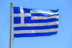 Greek flag on the blue sky background Royalty Free Stock Photo