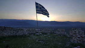 Greek flag at the castle of Paralio Astros Stock Image
