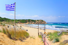 Greek flag and Elias bay beach, Skiathos Royalty Free Stock Photos