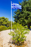 Greek flag on entry to Kamiros ruins Royalty Free Stock Images