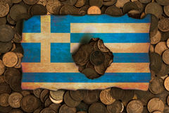 Greek flag on euro coins background Stock Photography