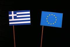 Greek flag with European Union EU flag isolated on black. Background Stock Photos