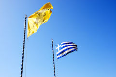 The Greek Flag and Flag of Varlaam monastery Royalty Free Stock Photography