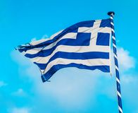 Greek flag on the flagpole. Under blue sky royalty free stock photo