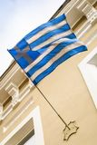 Greek flag flies on the building of old hotel in the tourist city in Russia.  Stock Photography
