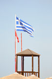 Greek flag floating on a white mat royalty free stock photography