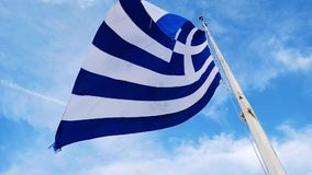 Greek flag flutters in the wind stock video footage