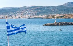 The Greek flag on the foreground of the seaside landscape stock photos
