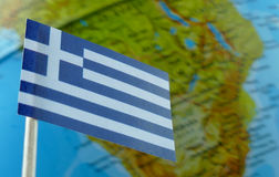 Greek flag with a globe map as a background Royalty Free Stock Photo