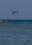 Greek flag. Flag of Greece has nine horizontal stripes - five blue and four white between them - in a blue square in the upper left corner of the white center Royalty Free Stock Photos