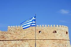 Greek flag and Heraklion castle, Crete. Royalty Free Stock Photos