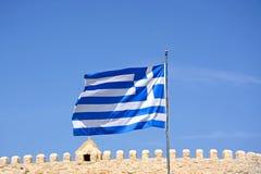 Greek flag by Heraklion castle, Crete. Royalty Free Stock Image