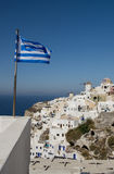 The Greek flag on the island a Santoriya Royalty Free Stock Photography