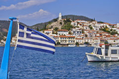 Greek flag and a island view Royalty Free Stock Photography