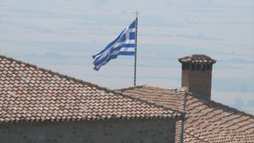 Greek flag in the rocks monasteries in Meteora stock video
