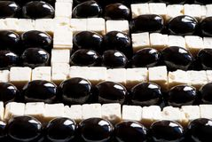 Greek flag made of food. Black olives and feta cheese stock photo