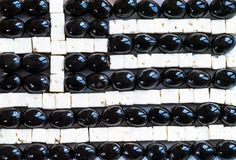 Greek flag from made of food. Feta cheese and black olives Royalty Free Stock Photos