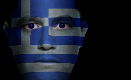 Greek Flag - Male Face. Greek flag painted/projected onto a man's face stock image