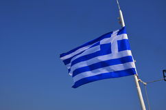 Greek flag. On the mast of a moving ferry from Skiathos to Skopelos Royalty Free Stock Photo