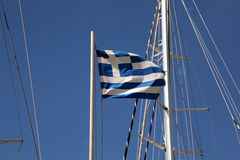 Greek flag on the mast of a yacht Royalty Free Stock Photos