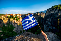 Greek flag on the mountains background Royalty Free Stock Image
