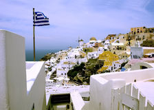 Greek flag in Oia town on Santorini Island. Stock Photos