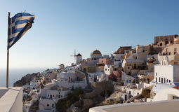 Greek flag in Oia village at Santorini island Royalty Free Stock Images