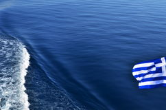 Greek flag over sea waters Stock Image