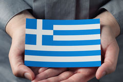 Greek flag in palms Stock Photo