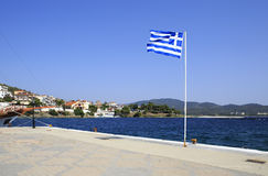 Greek flag on pier in Neos Marmaras Royalty Free Stock Photos