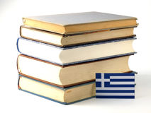 Greek flag with pile of books isolated on white background. Greek flag with pile of books isolated on white Royalty Free Stock Photos