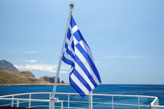 Greek flag on a pleasure boat Royalty Free Stock Photography