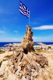 Greek flag on Porto Roxa beach on Zakynthos island Royalty Free Stock Photo