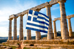 Greek flag on Poseidon temple background Stock Photo